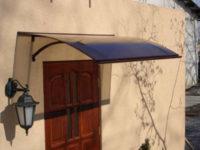 Tmavá polykarbonátová stříška nad vchodové dveře MISAM 160x87 cm